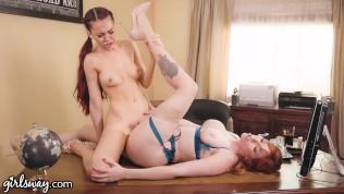 Busty Red Lesbian Boss Hazes Hot New Employee! -GIRLSWAY