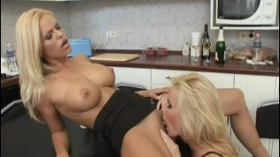 Gina eats friends pussy on kitchen table